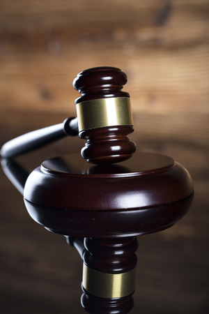 sell: Auction and business concept.  Gavel on the wooden background.