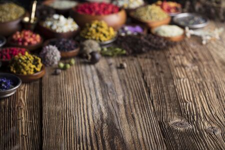 Fresh medicinal healing herbs on the wooden table