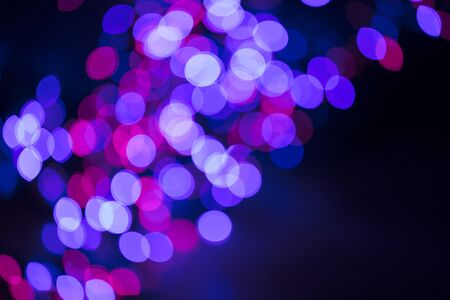 Casino bokeh lights. Pattern of defocused blue and red lights.