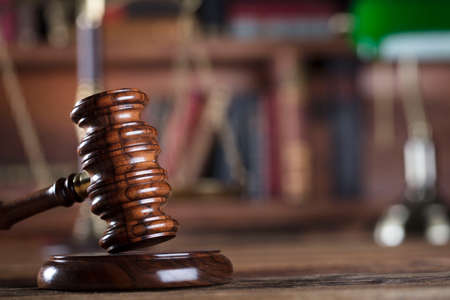 proceeding: Gavel of the jugde and scale of justice in the lawyer library. Stock Photo