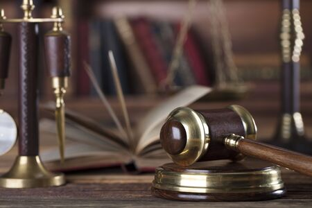 Gavel of the jugde and scale of justice in the lawyer library. Stock Photo