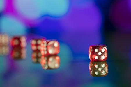 Dice on bokeh background. Casino concept.
