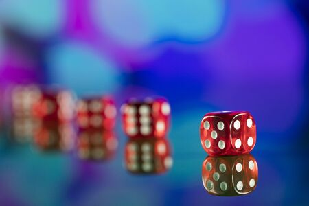Dice on bokeh background. Casino concept.