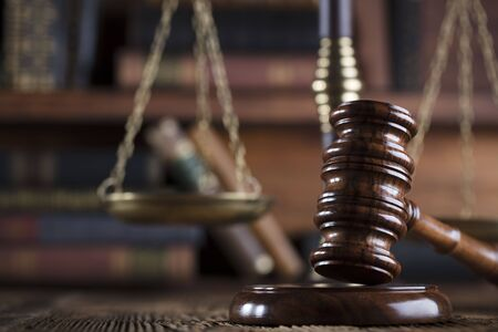 judicial proceeding: Gavel of the jugde and scale of justice in the court library. Stock Photo