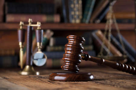 proceeding: Gavel of the jugde and scale of justice in the court library. Stock Photo