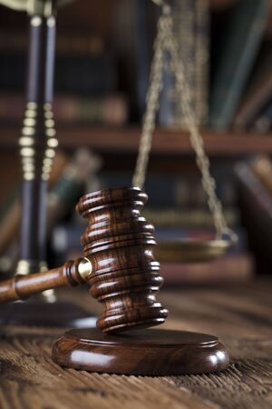 scale of justice: Gavel of the jugde and scale of justice in the court library. Stock Photo