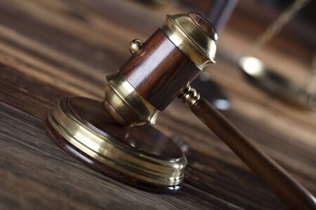Law concept. Gavel. Wooden background.