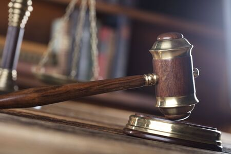 Law and justice concept - gavel of judge and scale of justice on wooden table Stock Photo