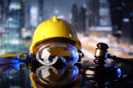 Law theme. Construction law's symbols  - helmet and gavel. Standard-Bild