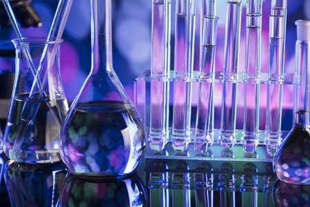 Laboratory concept. Beakers and test-tubes. Coloful bokeh background.