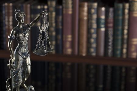 Court library – statue  of justice and books. Stock Photo