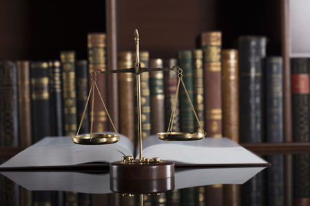 Court library – scale  of justice and books.