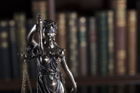 penal system: Court library – statue  of justice and books. Stock Photo