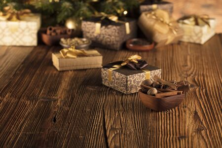 Christmas decoration and gifts on a rustic wooden background.Christmas decoration and gifts on a rustic wooden background.