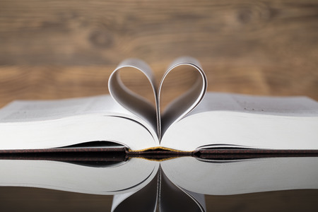 Holy Bible on wooden background.