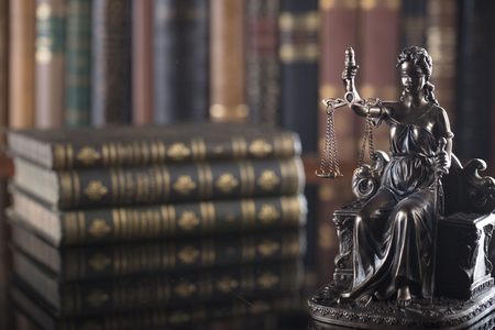 Law concept. Statue of justice in old court library. Foto de archivo
