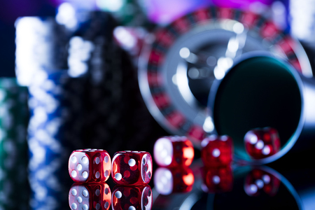 Gambling in casino. Poker chips. Roulette wheel and dice.