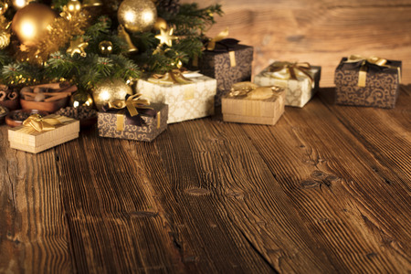 Christmas concept background. Christmas decoration and gifts on a rustic wooden background.