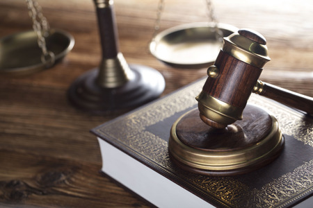 Judge antique gavel. Law symbols. Legal office. Wooden table and background. Stock Photo - 91471418