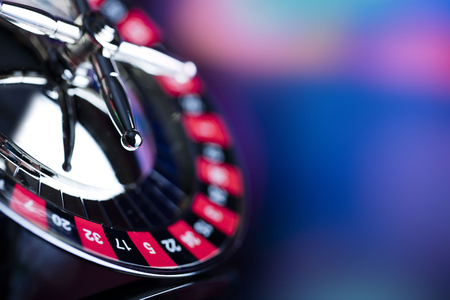 Casino theme. High contrast image of casino roulette on a gaming table and on colorful bokeh background. Reklamní fotografie - 91839106