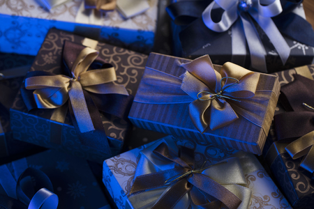 Gift giving concept. Presents on wooden table.