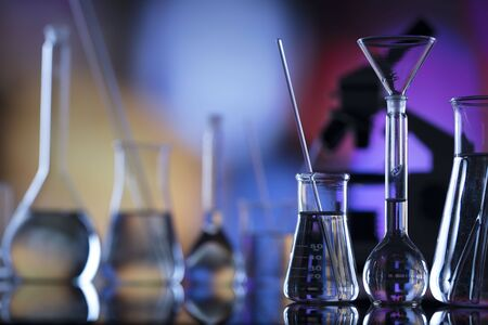 Science concept background. Microscope and laboratory glassware composition.