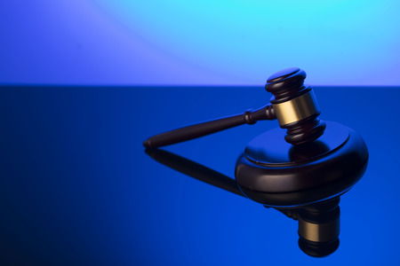 Law symbol. Gavel on blue background. Place for or text.