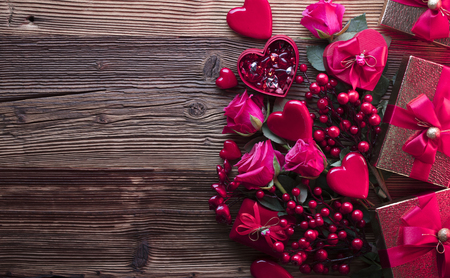 Valentines day background. Hearts, roses, gifts and romantic decorations  on rustic wooden table. Place for typography. Stock Photo