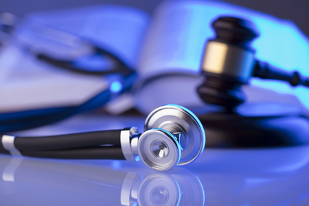 Medical law concept. Gavel, stethoscope, blue light. Place fort text. 免版税图像 - 94917955