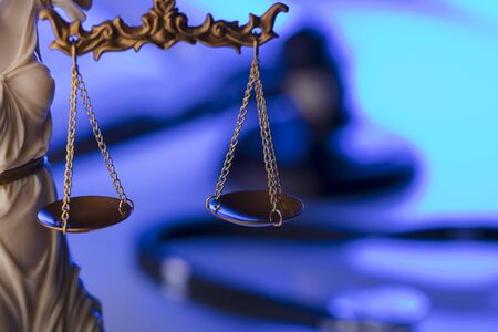Medical law concept. Statue of justice, gavel and stethoscope, blue light. Place fort text. Foto de archivo - 96130401