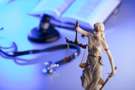 Medical law concept. Statue of justice, gavel and stethoscope, blue light. Place fort text. Imagens - 96130413