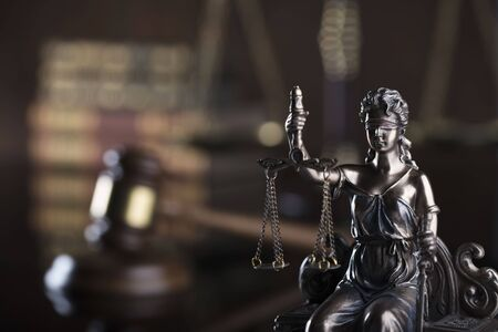 Law code. Statue of justice, gavel and  books. Brown background. Place for text.