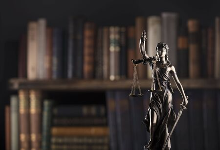Law symbols on brown background. Statue of justice - Themis.