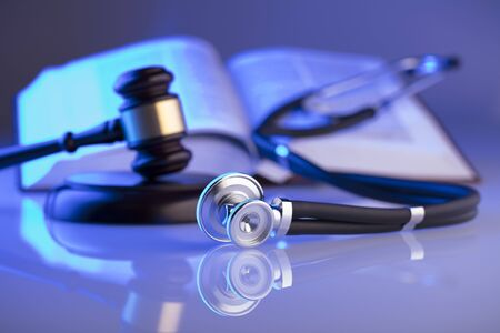 Medical law concept. Gavel, stethoscope, blue light. Place fort text.