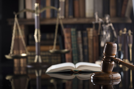 Law theme. Mallet of the judge. Books. Scale of justice, statue of justice. Stock Photo