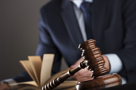 Law concept. Judge, gavel. White collar, man in suit. Stock Photo