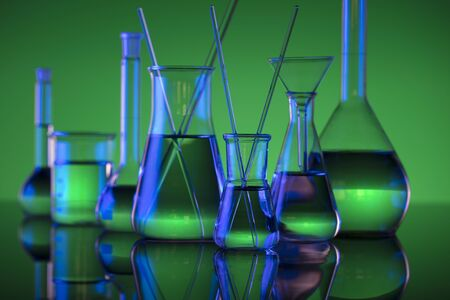 Chemical laboratory concept. Experiment with liquids.  Green background. Place for logo. Stok Fotoğraf
