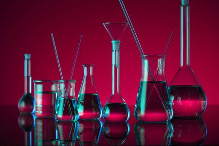 Chemical laboratory concept. Experiment with liquids. Red background. Stok Fotoğraf