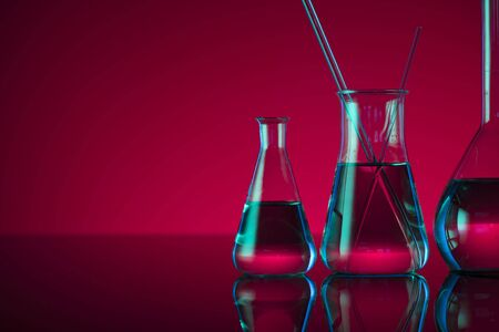 Chemical laboratory concept. Experiment with liquids. 版權商用圖片