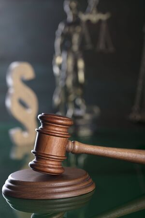 The law concept background. Mallet oft the judge, scale of justice, Themis and paragraph sign – symbols of the law. Stock Photo