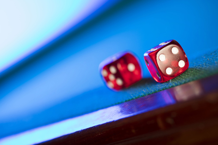 Gambling theme.  Dice and poker chips  on casino table.
