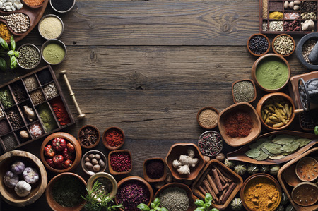 Nutrition theme. Collection of spices in bowls on wooden rustic table.