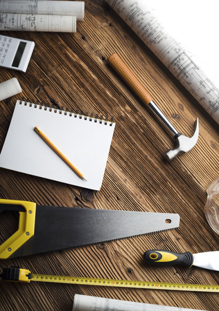 Construction and renovation concept. Building contractor tools on wooden table. Top view. Banco de Imagens