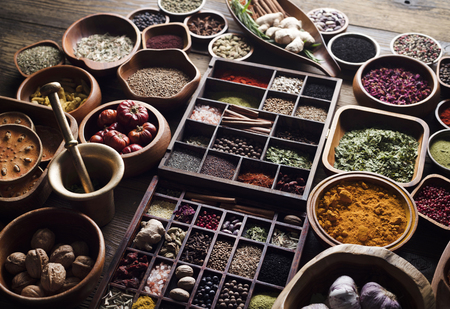 Spices theme. Collection of spices in bowls on wooden rustic table. Stock Photo