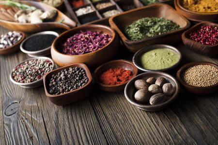 Spices theme. Collection of spices in bowls on wooden rustic table. 写真素材