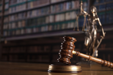 Law and justice theme – court library. Gavel and Themis statue. Stock Photo