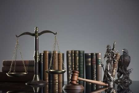 Law and justice concept background. Themis, mallet, scale and legal book on the gray background.