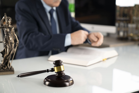 Lawyer concept background. Lawyer working at the office.