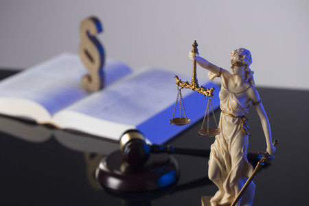 Law concept. Gavel of  the judge, scale, statue of the justice and legal book. Gray background. Stock Photo