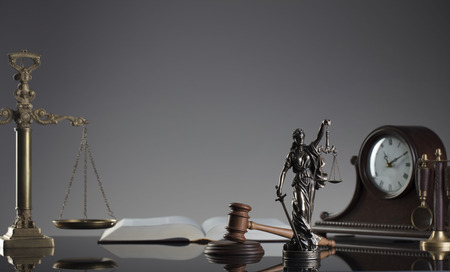 Law concept. Gavel of  the judge, scale, statue of justice and legal books. Gray background.